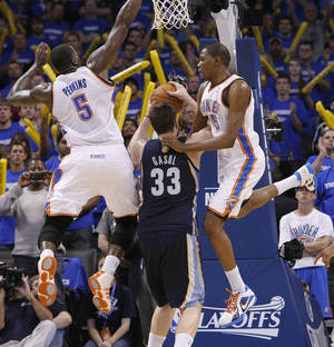 photo - Oklahoma City's Kendrick Perkins (5) and Oklahoma City's Kevin Durant (35) defend on Marc Gasol (33) of Memphis during game two of the Western Conference semifinals between the Memphis Grizzlies and the Oklahoma City Thunder in the NBA basketball playoffs at Oklahoma City Arena in Oklahoma City, Tuesday, May 3, 2011. Photo by Chris Landsberger, The Oklahoman