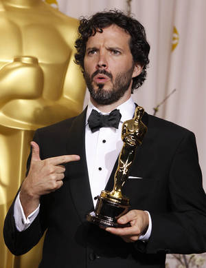 "Bret McKenzie poses with his award for best original song for ""Man or Muppet"" during the 84th Academy Awards on  Feb. 26 in Los Angeles. AP Photo"