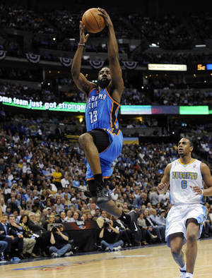 Photo - Oklahoma City Thunder guard James Harden (13) breaks away for a dunk against Denver Nuggets guard Arron Afflalo (6) during the first half of game 3 of a first-round NBA basketball playoff series Saturday, April 23, 2011, in Denver. (AP Photo/Jack Dempsey)