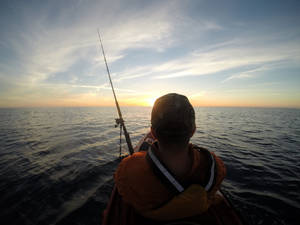 Photo - Ryan Jones of Yukon, the assistant manager of the OKC Kayak store, fishes in the Atlantic Ocean from a Hobie Outback kayak. <strong>Photo provided</strong>