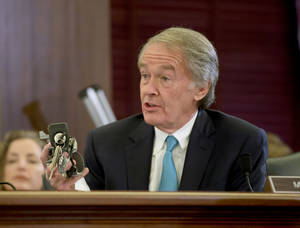 Photo - Sen. Edward Markey, D-Mass. holds up a GM ignition switch while questioning General Motors CEO Mary Barra on Capitol Hill in Washington, Wednesday, April 2, 2014, during a Senate Commerce, Science and Transportation subcommittee hearing. Barra was back before Congress, where members of a Senate subcommittee are expressing doubts that the culture at the nation's No. 1 automaker has really changed.  (AP Photo/Pablo Martinez Monsivais)