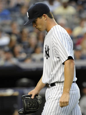 Photo -   New York Yankees pitcher Adam Warren walks off the field after being removed from the baseball game during the third inning against the Chicago White Sox on Friday, June 29, 2012, at Yankee Stadium in New York. (AP Photo/Bill Kostroun)