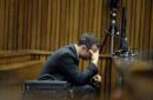 Photo - Olympic and Paralympic track star Oscar Pistorius reacts during a testimony at the North Gauteng High Court in Pretoria March 10, 2014. Pistorius is on trial for murdering his girlfriend Reeva Steenkamp at his suburban Pretoria home on Valentine's Day last year. REUTERS/Bongiwe Mchunu/Pool (SOUTH AFRICA - Tags: SPORT ATHLETICS CRIME LAW)