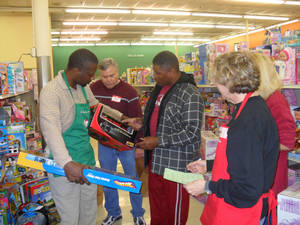 Photo - Volunteers help Shoppers choose just the right toys  as part of Christmas Connection. Photo provided.  <strong></strong>