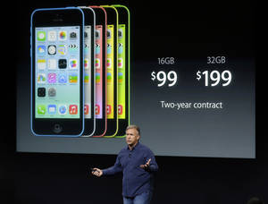 Photo - Phil Schiller, Apple's senior vice president of worldwide product marketing, speaks on stage during the introduction of the new iPhone 5c in Cupertino, Calif., Tuesday, Sept. 10, 2013. (AP Photo/Marcio Jose Sanchez)