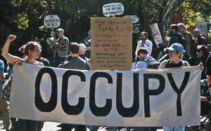 Photo - Protesters representing the Occupy Wall Street  movement, rally on Tuesday, Sept. 17, 2013, in Washington Square Park in New York.  It has been two years since protesters first pitched tents in lower Manhattan, sparking the movement against corporate greed known as Occupy Wall Street.  (AP Photo/Bebeto Matthews)