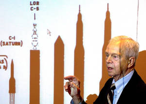 Photo - File-This Oct. 9, 2003, file photo shows John C. Houbolt explaining the size of different rockets required to launch various methods for landing on the moon at Grainger Engineering Library in Urbana, Ill. Houbolt, an engineer whose contributions to the U.S. space program were vital to NASA's successful moon landing in 1969, has died. He was 95. Houbolt's family confirmed his death Tuesday, April 15, 2014, at a Maine nursing home of complications from Parkinson's disease. (AP Photo/News-Gazette, John Dixon, File)