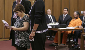 Photo - FILE - In this Thursday, Aug. 1, 2013 file photo, Michelle Knight speaks during the sentencing phase for Ariel Castro, right, in a Cleveland courtroom. The list of missing people in Cleveland makes up about one out of every 10 cases in the entire state. Most are found within a few weeks, but there are more than 22 people who have been gone for more than a year. (AP Photo/Tony Dejak, File)