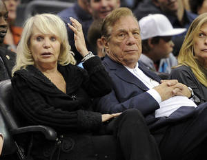 Photo - FILE - In this Nov. 12, 2010, file photo, Los Angeles Clippers owner Donald T. Sterling, right, sits with his wife Rochelle during the Clippers NBA basketball game against the Detroit Pistons in Los Angeles. An attorney representing the estranged wife of Clippers owner Donald Sterling said Thursday, May 8, 2014, that she will fight to retain her 50 percent ownership stake in the team.  (AP Photo/Mark J. Terrill, File)