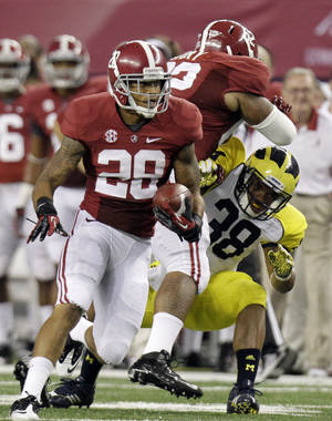 Photo -   Alabama defensive back Dee Milliner (28) runs back a turnover as teammate Brandon Ivory (62) puts a block on Michigan running back Thomas Rawls (38) during the first half of an NCAA college football game at Cowboys Stadium in Arlington, Texas, Saturday, Sept. 1, 2012. (AP Photo/LM Otero)