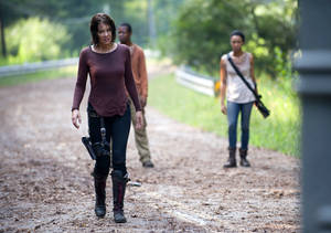 "Photo - This undated image released by AMC shows Lauren Cohan as Maggie Greene, left, in a scene from ""The Walking Dead. Cohan says being on the series for three seasons has changed her temperament after being immersed in dark material. (AP Photo/AMC, Gene Page)"