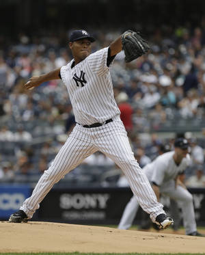 Photo - New York Yankees' Ivan Nova delivers a pitch during the first inning of a baseball game against the Baltimore Orioles Saturday, Aug. 31, 2013, in New York.The (AP Photo/Frank Franklin II)