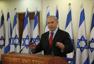 photo - Israel's Prime Minister Benjamin Netanyahu delivers a statement at his office in Jerusalem, Wednesday, Jan. 23, 2013. A weakened Netanyahu scrambled Wednesday to keep his job by extending his hand to a new centrist party that advocates a more earnest push on peacemaking with the Palestinians and whose surprisingly strong showing broadsided him with a stunning election deadlock. (AP Photo/Darren Whiteside, Pool)
