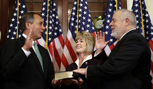 Photo -   In this Nov. 13, 2012 file photo, House Speaker John Boehner of Ohio, left, performs a mock swearing in for Rep. David Curson, D-Mich., accompanied by his wife Sharon Curson, on Capitol Hill in Washington. Driving from Michigan in his Ford F150 pickup truck, Curson arrived in Washington a week ago. He set up an office last Sunday, was sworn in on Tuesday and by Friday had logged his first votes and given his first floor speech _ one that stretched a bit past the one-minute he'd been allotted. The 64-year-old Democrat has no time to waste. In six weeks, he'll be gone. (AP Photo/Alex Brandon, File)