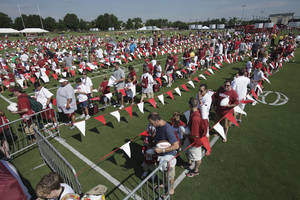 Photo - Fans wait in line as the University of Oklahoma football team holds media/fan appreciation day on Friday, August 6, 2010, in Norman, Okla. Photo by Steve Sisney, The Oklahoman