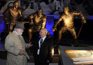 Photo -   Jerry McKenna, left, the American sculptor commissioned to construct the statue, and Ron Moscati, whose photograph became the inspiration of the famed hockey players, talk in front of the First Niagara Center Friday, Oct. 12, 2012, in Buffalo, NY. The Sabres are honoring their past by unveiling a statue of the team's famed French Connection line 40 years after Gilbert Perreault, Rene Robert and the late Rick Martin first hit the ice together in Buffalo. (AP Photo/Gary Wiepert)