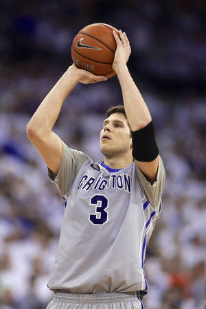 Photo - In this March 8, 2014, photo, Creighton's Doug McDermott shoots against Providence during an NCAA college basketball game in Omaha, Neb. McDermott accepted the John R. Wooden Award on Friday night, April 11, 2014, one of several honors the senior won this year as college basketball's player of the year. The women's award went to Chiney Ogwumike of Stanford in a ceremony at the Los Angeles Athletic Club. (AP Photo/Nati Harnik)