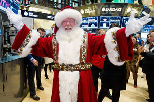 Photo -   In this photo provided by the New York Stock Exchange, a man portraying Santa Claus visits the trading floor of the New York Stock Exchange, Wednesday Nov. 21, 2012 before he participated in opening bell ceremonies featuring the Macy's Thanksgiving Day Parade. Stocks hovered near break-even Wednesday on Wall Street ahead of the Thanksgiving holiday. (AP Photo/NYSE Euronext, Ben Hider)