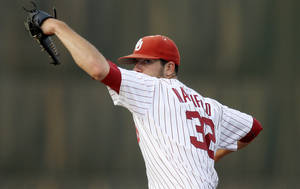 Photo - OU / UNIVERSITY OF OKLAHOMA / COLLEGE BASEBALL: Oklahoma's Damien Magnifico pitches  against Arkansas at L. Dale Mitchell Park in Norman, Okla., Tuesday, April 10, 2012. Photo by Bryan Terry, The Oklahoman