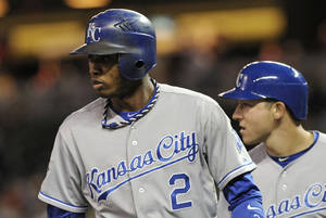 Photo -   Kansas City Royals' Alcides Escobar, left, and David Lough watch the play after they scored on a two-run single to left by Billy Butler in the fifth inning off Minnesota Twins pitcher P.J. Walters in a baseball game on Wednesday, Sept. 12, 2012, in Minneapolis. (AP Photo/Jim Mone)