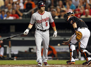 Photo -   Washington Nationals' Danny Espinosa (8) walks off the field after striking out in the second inning of a baseball game against the Baltimore Orioles in Baltimore, Friday, June 22, 2012. Baltimore won 2-1. (AP Photo/Patrick Semansky)