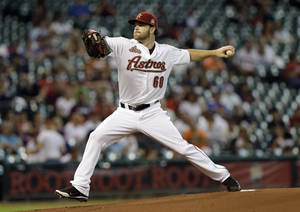 Photo -   Houston Astros starting pitcher Dallas Keuchel throws during the first inning of a baseball game against the Philadelphia Phillies, Saturday, Sept. 15, 2012, in Houston. (AP Photo/David J. Phillip)
