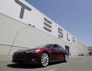 Photo - FILE - This June 22, 2012 file photo shows a Tesla Model S outside the Tesla factory in Fremont, Calif. The Tesla Model S electric sedan is Consumer Reports' top pick in this year's automotive survey. (AP Photo/Paul Sakuma, File)