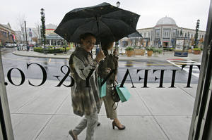 Photo - FILE - In this Nov. 7, 2008 file photo, shoppers look in through a window at Tiffany & Co.'s new store at Easton Town Center in Columbus, Ohio. Jewelry retailer Tiffany & Co. said Friday, March 22, 2013, its fourth-quarter net income edged up less than 1 percent, but managed to beat Wall Street predictions. (AP Photo/Kiichiro Sato, File)