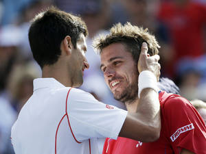 Photo - Novak Djokovic, of Serbia, left greets Stanislas Wawrinka, of Switzerland, at the net after beating him in five sets at the semifinals of the 2013 U.S. Open tennis tournament, Saturday, Sept. 7, 2013, in New York. (AP Photo/David Goldman)