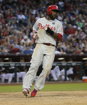 Photo - Philadelphia Phillies' Tony Gywnn Jr. scores on a ground out by Jimmy Rollins during the seventh inning of a baseball game against the Arizona Diamondbacks on Saturday, April 26, 2014, in Phoenix. (AP Photo/Matt York)