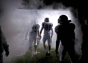 photo - The Blanchard team takes the field before the Class 3A football championship between Blanchard and Kingfisher at Boone Pickens Stadium in Stillwater, Okla., Friday, Dec. 7, 2012.  Photo by Bryan Terry, The Oklahoman