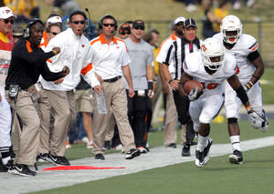 Photo - Oklahoma State coaches react to Oklahoma State's Brodrick Brown (19)interception during a college football game between the Oklahoma State University Cowboys (OSU) and the University of Missouri Tigers (Mizzou) at Faurot Field in Columbia, Mo., Saturday, Oct. 22, 2011. Photo by Sarah Phipps, The Oklahoman