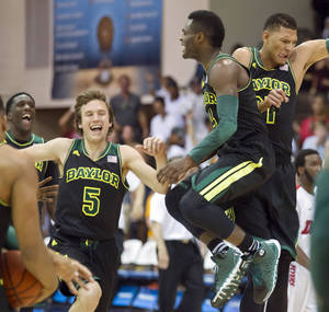 Photo - Baylor guard Brady Heslip (5) and his teammates guard Gary Franklin, center, and center Isaiah Austin, right,  celebrat their 67-66 win over Dayton in an NCAA college basketball game at the Maui Invitational on Tuesday, Nov. 26, 2013, in Lahaina, Hawaii.  (AP Photo/Eugene Tanner)