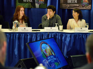 Photo - Nicol Austin, left, of Kings County Distillery, Alejandro del Peral, center, and his mother Sonya del Peral of Albany's Nine Pin Cider Works speak during the Wine, Beer, Spirits and Cider Summit, Tuesday, April 8, 2014. in Albany, N.Y. (AP Photo/Albany Times Union, John Carl D'Annibale)
