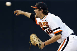 Photo - OSU's Jon Perrin (46) pitches during Game 1 of the NCAA baseball Stillwater Super Regional between Oklahoma State and UC Irvine at Allie P. Reynolds Stadium in Stillwater, Okla., Friday, June 6, 2014. Photo by Nate Billings, The Oklahoman