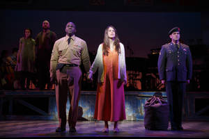 This image released by Polk & Co. shows, foreground from left, Joshua Henry, Sutton Foster and Colin Donnell during a performance of Violet in New York. (AP Photo/Polk & Co., Joan Marcus)