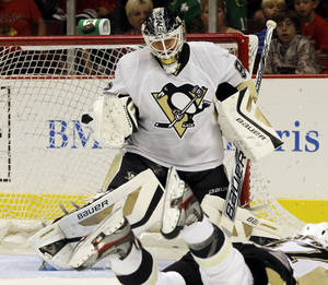 Photo - Pittsburgh Penguins goalie Tomas Vokoun blocks a shot by Chicago Blackhawks' Patrick Kane during the second period of an NHL preseason hockey game in Chicago, Thursday, Sept. 19, 2013. (AP Photo/Nam Y. Huh)