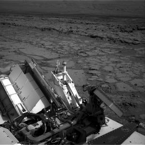 "Photo - FILE - This Dec. 12, 2012 file image provided by NASA shows the Mars rover Curiosity at a pit stop, a shallow depression called ""Yellowknife Bay.""  It took the image on the 125th Martian day, or sol, of the mission (Dec. 12, 2012), just after finishing that sol's drive. The Sol 125 drive entered Yellowknife Bay and covered about 86 feet (26.1 meters). The descent into the basin crossed a step about 2 feet (half a meter) high, visible in the upper half of this image. Curiosity will now head for Mount Sharp in mid-February after it drills into its first rock. (AP Photo/NASA/JPL-Caltech, File)"