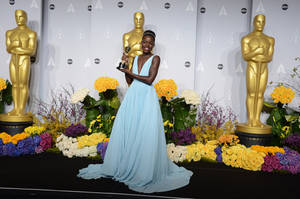 "Photo - Lupita Nyong'o poses in the press room with the award for best actress in a supporting role for ""12 Years a Slave"" during the Oscars at the Dolby Theatre on Sunday, March 2, 2014, in Los Angeles.  (Photo by Jordan Strauss/Invision/AP)"