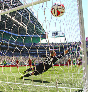 Photo - Real Salt Lake goalkeeper Jeff Attinella can't cover a penalty kick by Sounders FC's Gonzalo Pineda in the 42nd minute in an MLS match at CenturyLink Field on Saturday, May 31, 2014, in Seattle, Wash. Sounders FC won, 4-0. (AP Photo/The Seattle Times, John Lok)