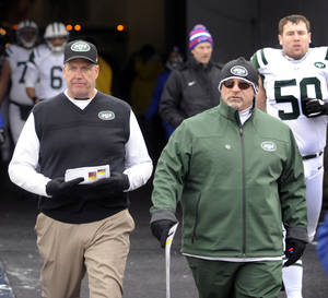 photo - FILE - This Dec. 30, 2012 file photo shows New York Jets head coach Rex Ryan, left, walking with offensive coordinator Tony Sparano after halftime of an NFL football game against the Buffalo Bills in Orchard Park, N.Y. Sparano has been fired as the Jets' offensive coordinator, Tuesday, Jan. 8, 2013,  after one season in which the offense ranked among the league's worst.(AP Photo/Gary Wiepert, File)