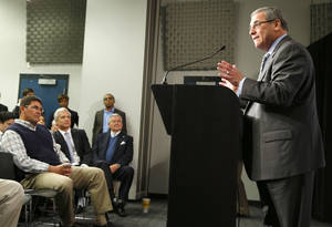 photo - Carolina Panthers' new general manager Dave Gettleman, right, speaks during a news conference for the NFL football team in Charlotte, N.C., Tuesday, Jan. 15, 2013 as Panthers head coach Ron Rivera, left, team president Danny Morrison, second from left, and owner Jerry Richardson, seated at right, look on. (AP Photo/Chuck Burton)