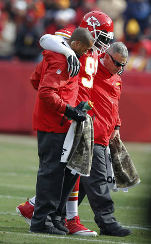 Photo - Kansas City Chiefs outside linebacker Tamba Hali (91) is helped from the field during the first half of an NFL football game against the San Diego Chargers in Kansas City, Mo., Sunday, Nov. 24, 2013. (AP Photo/Ed Zurga)