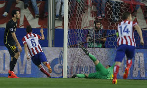Photo - Atletico's Koke celebrates after scoring the opening goal during the Champions League quarterfinal second leg soccer match between Atletico Madrid and FC Barcelona at the Vicente Calderon stadium in Madrid, Spain, Wednesday, April 9, 2014. (AP Photo/Andres Kudacki)