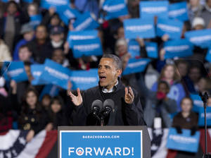 Photo -   In the final hours of a four-state campaign day, President Barack Obama speaks at a rally at Jiffy Lube Live arena, late Saturday night, Nov. 3, 2012, in Bristow, Va. Virginia is one of the most closely contested battleground states. (AP Photo/J. Scott Applewhite)