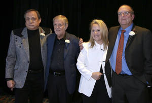Photo -   Kim Williams, left; Larry Henley, second from left; Mary Chapin Carpenter, second from right; and Tony Arata, right; pose together before they are inducted into the Nashville Songwriters Hall of Fame on Sunday, Oct. 7, 2012, in Nashville, Tenn. (AP Photo/Mark Humphrey)