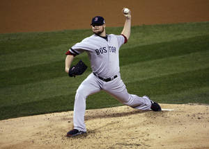 Photo - Boston Red Sox starting pitcher Jon Lester throws during the second inning of Game 5 of baseball's World Series against the St. Louis Cardinals Monday, Oct. 28, 2013, in St. Louis. (AP Photo/David J. Phillip)