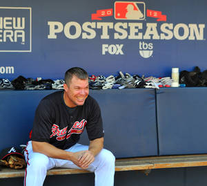 Photo -   Atlanta Braves Chipper Jones takes a break in the dugout during batting practice at Turner Field Thursday, Oct. 4, 2012, in Atlanta. The Braves take on St. Louis Cardinals in the NL wild-card baseball game on Friday. (AP Photo/Atlanta Journal-Constitution, Brant Sanderlin) MARIETTA DAILY OUT; GWINNETT DAILY POST OUT; LOCAL TV OUT; WXIA-TV OUT; WGCL-TV OUT