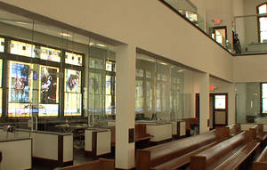Photo -      Glass-walled offices surround the former sanctuary after the renovation of Calvary Baptist Church, which was transformed into a law office while retaining much of its former architectural character. Photo by Tim Money, NewsOK.com  <strong>Tim Money -   </strong>