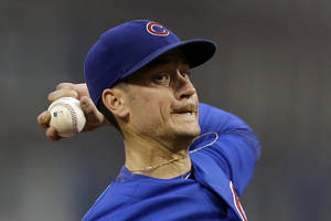 Photo - Chicago Cubs starting pitcher Chris Rusin delivers during the first inning of a baseball game against the Pittsburgh Pirates in Pittsburgh, Thursday, Sept. 12, 2013. (AP Photo/Gene J. Puskar)